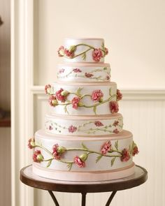 Victorian-Era Silk Wedding Cake  To mimic its tactile quality for a cake, Ron Ben-Israel marshaled all of the ardent attention to detail of the era's seamstresses, shaping sugar-paste carnations by hand before affixing them to the sides of three fondant-covered tiers. Tucked between the sumptuous carnation-bedecked layers are two shorter tiers decorated with icing and sugar-paste flowers and stems.