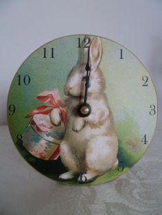 "Our Mini Bunny Clock features a pretty vintage bunny with a hatbox lightly glittered on a 5"" round wood clock. I love it all year round! $21.00 www.nobleniches.com"