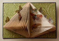 Rachael Ashe. The Butterfly Effect. Recycled book, Japanese paper, gel medium, resistors, transparent butterflies.