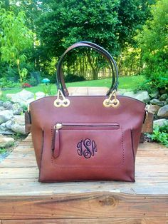This monogrammed purse is great for the girls who like to change up the way they rock their bags. With a shoulder and cross body the styles are endless.