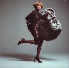 """Lauren Hutton in """"blaze and feathers from Norell."""""""