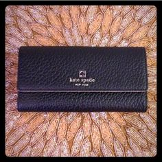 """♠️Kate Spade Wallet & Clutch♠️ 100% authentic and brand new! Black pebble-embossed leather. 14K gold hardware. Continental wallet style with snap closure. Custom woven interior lining. 5 credit card slots, 1 clear ID window, full zip compartment, 4 long bill slots, and an exterior rear slip pocket. Measures 7.75"""" x 4.5"""" x 1"""". Can also be used as a clutch purse for a night out b/c my iPhone and keys fit inside! kate spade Bags Wallets"""