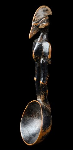 Africa | Spoon from the Senufo people of the Ivory Coast | Wood; light brown wood, shiny blackish brown patina, round ladle, handle in form of a bird creature with forehead crest