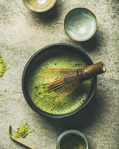Flat-lay of Japanese tools for brewing matcha tea. Matcha powder in tin can, Chashaku spoon, Chasen bamboo whisk, Chawan bowl and cups for ceremony over concrete background, top view Macha Tea, Tea Wallpaper, Korean Tea, Matcha Whisk, Thé Oolong, Japanese Matcha, Tea Culture, Tea Powder, Japanese Tea Ceremony