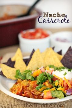 Nacho Casserole, a yummy casserole that comes together and is ready to serve in less than an hour. Beef, Beans, Cheese and all your favorite nacho toppings. ~ http://reallifedinner.com