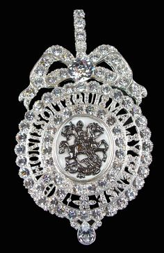 Order of the Garter Queen Victoria's sash badge (Lesser George). The centre is a brown cameo of St. George attacking the dragon with a sword. This is encircled by an open garter with an inner boarder of 20 brilliants and an outer boarder of 31 brilliants. British Crown Jewels, Royal Crown Jewels, Royal Crowns, Royal Tiaras, Royal Jewelry, Tiaras And Crowns, Queen Victoria Wedding, Just Over The Top, Antique Jewelry