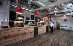Parcel Yeard, Fullers, modern pub, reclaimed wood panelling, white brick