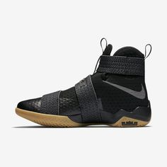 89158aaa06e2 The Nike LeBron Soldier 10 returns in a classic Black Gum colorway  featuring reflective Swoosh branding.