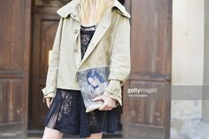 Model Nastia Shershen poses wearing a Carven jacket and N21 bag and dress on June 21, 2015 in Milan, Italy.