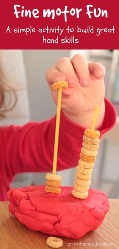 Threading cheerios onto lengths of spaghetti is a great simple fine motor activity for toddlers and preschoolers that uses everyday items