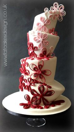 Claret ombre quilled sugar flowers on a wonky topsy turvy cake!! A striking colour combination and quirky style.