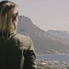 Model looking over Clifton landscape, Cape Town.