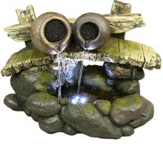 """Twin streams of water flowing from two tipped over pots on a wooden bridge in this lighted tabletop fountain.  Fiberglass with look of natural wood and stone gives the strength and durability to use indoors or out.  14"""" x 7"""" x 10"""" high."""