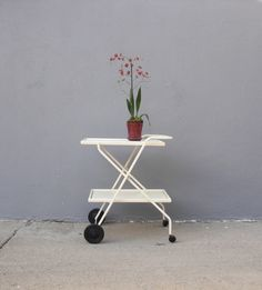 Rolling Ivory Bar Cart Mid Century Modern I would love to cover this in cactuses and succulents Office Furniture Design, Housewarming Party, Mid Century House, Bar Cart, Coffee Shop, House Warming, Architecture Design, Mid-century Modern, Home Goods