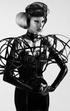 Sculptural fashion with scaffolding-like 3D cage construct - dark fashion; experimental fashion design // Zana Bayne