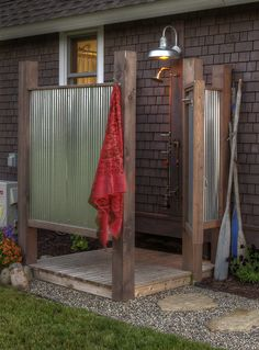 An outdoor solar powered shower is appealing to the cabin owner because of its simplicity.