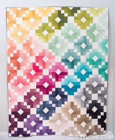 Ombre Gems Quilt Pattern by Emily of Quilty Love.A Modern quilt pattern.Ombre gems is made using jelly roll strips or a fat quarter bundle.  This quilt pattern