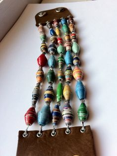 Paper Beads on Brown Leather - etsy $45