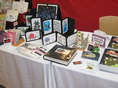 """Easy way to display postcards  (""""My TCAF table setup   by DH."""")"""