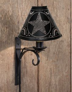 North Folk wall lamp with star shade. Available at www.shabbyshedprimitives.com