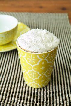 Coconut Lover's Mug Cake == Mom.me (Cake: 4 T flour, 1/4 tsp. baking powder, 2 tsp. sugar, 2 T coconut milk, 1 T coconut water, 1/2 T oil, 1-1/2 T coconut  //  Topping: 1/2 C heavy whipping cream, 2 tsp. sugar, 1 T coconut)