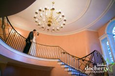 Hannah and Travis on the grand stairs case of the Brantwyn Mansion and Estate in Wilmington, DE  Photo Credit: Lindsay Docherty Photography www.DuPontCountryClub.com/weddings