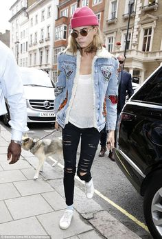 London calling: Suicide Squad star Cara Delevingne was spotted out and about in London with her pet dog Leo ahead of the premiere in her home city
