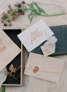 tri-fold invitation with wax seal and silk ribbon