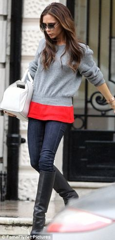 Taking it in her stride: Victoria looked like she meant business as she walked briskly along