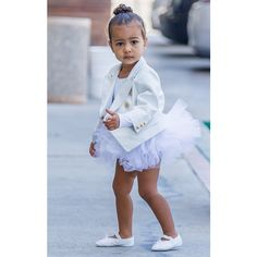 North West Takes the Ballerina Bun to New Heights ❤ liked on Polyvore