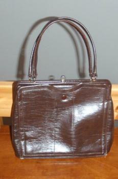 Ruskea käsilaukku