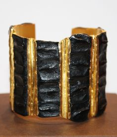 Astoria Couture - NADA SAWAYA / Crocodile Cuff W/Brass in Black, $495.00 (http://www.astoriacouture.com/nada-sawaya-crocodile-cuff-w-brass-in-black/)