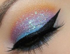 Glitter shadow. Winged liner.