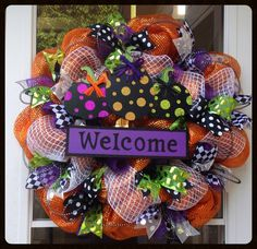 This fun and whimsical Halloween wreath is loaded with shiny, bright ribbon and sparkly deco mesh! It is extra-large and measures 28 in diameter Steph's Door Decor