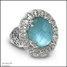 Lusciouss blue topaz over mother of pearl ring