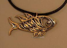 Quilled fish pendant.