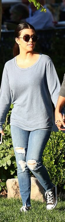 Kourtney Kardashian: Shoes – Converse  Sunglasses – The Row  Jeans – J Brand