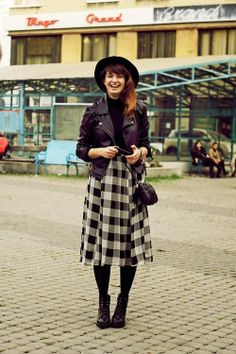 leather coat and plaid skirt