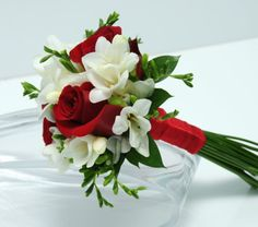 Three Rose Bouquet Freesia Red Vegas Wedding Flowers is part of Red bouquet wedding - This bouquet has three sensational roses surrounded by beautiful mixed greenery and matching ribbon Prom Bouquet, Red Rose Bouquet, Red Bouquet Wedding, Prom Flowers, White Wedding Flowers, Bridesmaid Flowers, Bride Bouquets, Freesia Bouquet, Flower Bouquets