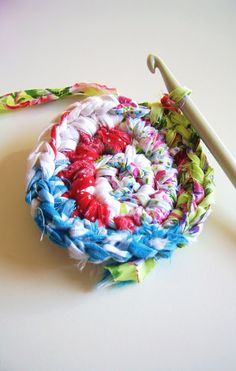 Crochet with fabric strips!!!!! Love this for a few things for the baby... a rug for her room... a poof to play on... maybe even a little cardigan.