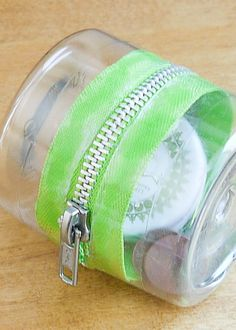 Plastic-Bottle Zipper Container Simply made from two identical diameter bottles, glue and a zipper. When I tried this, I softened the sharp scissor-cut edge with a lighter flame.