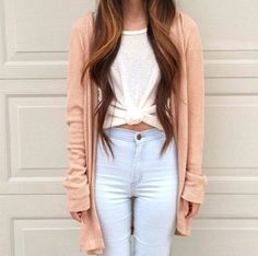Love the pastel color combinations with the pastel peach cardigan, white tied tee, and pastel light blue jeans.
