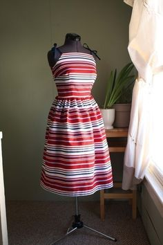 http://www.etsy.com/listing/27477621/vintage-inspired-striped-sun-dress?ref=cat2_gallery_10