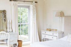 Hang heftier curtains in your bedroom.
