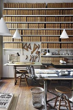 "A wall of Magazine/Book holders is ideal (maybe not in brown) but the concept is wonderful. A ""wall papered"" wall ... Tee hee"