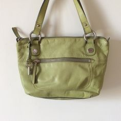 Gorgeous Fossil lime green leather bag Lime green marshmallow leather....so soft.   In excellent condition.  Zipper pocket on front, pouch on back,   Same inside.   032310 Fossil Bags Satchels