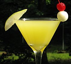 Pearadise   (2 oz. Absolut Pears Vodka 1 oz. Limoncello .5 oz Ginger Vodka 1.5 oz. Orange Juice 1.5 oz. 7-Up 1 Tbsp. Simple Syrup Pear wedge and/or Pear ball and/or Cherry to garnish)