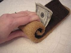 Creative Ways to Give Cash ~ Creative Ways to Wrap Money.      1 light brown washcloth     1 dark brown washcloth     1 wide coffee mug  Money is place on folded washcloths.  Then washcloths are rolled up with money inside.  Place the roll in a wide mouth coffee mug. It looks like a mug of coffee/mocha..http://www.aokcorral.com/projects/how2jan2009.htm