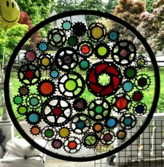 Stained glass bicycle wheel - recycled bicycle art on Etsy, $550.00. I need this!