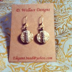 Art deco curves. Antique buttons and crystals